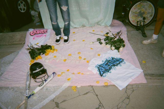 on set photo of Cailee & Antonio