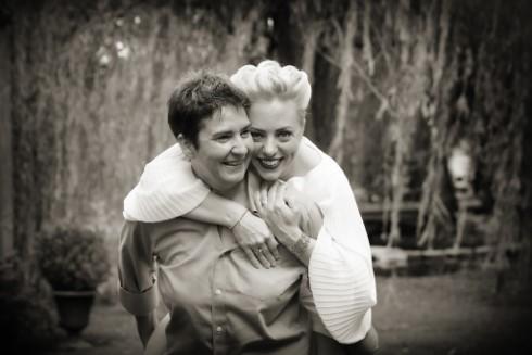 Talia Hollis-Elwell and wife